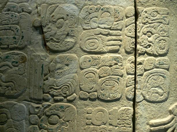 Maya glyphs on stone